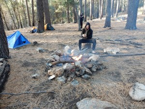 Ryan contemplate uses for aluminum foil by the camp fire.