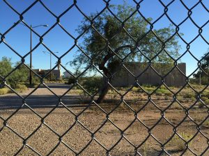 All that remains of the original Tucson Magnetic Observatory is behind chain-link fence, waiting for possible restoration.